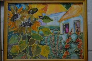 Соняшники біля хати